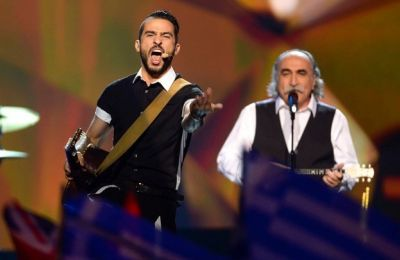 Το 2013, σε συνεργασία με το συγκρότημα «Κoza Mostra», εκπροσώπησε την Ελλάδα στον ευρωπαϊκό διαγωνισμό τραγουδιού της Eurovision